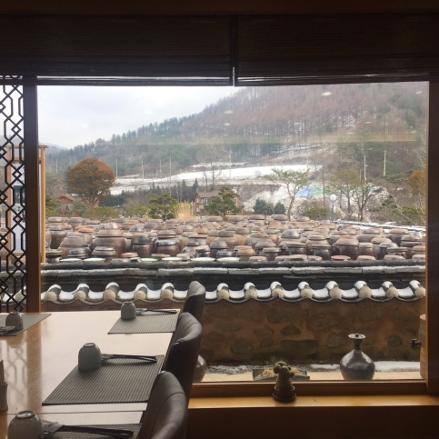 Looking out to Jung Gang Won's window into the yard of Traditional claypots