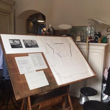Achille's drafting desk in the center of studio