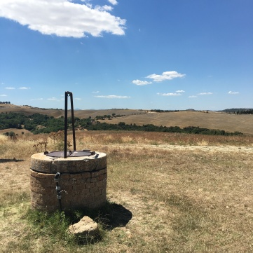 Waterwell in perfect distance from chapel
